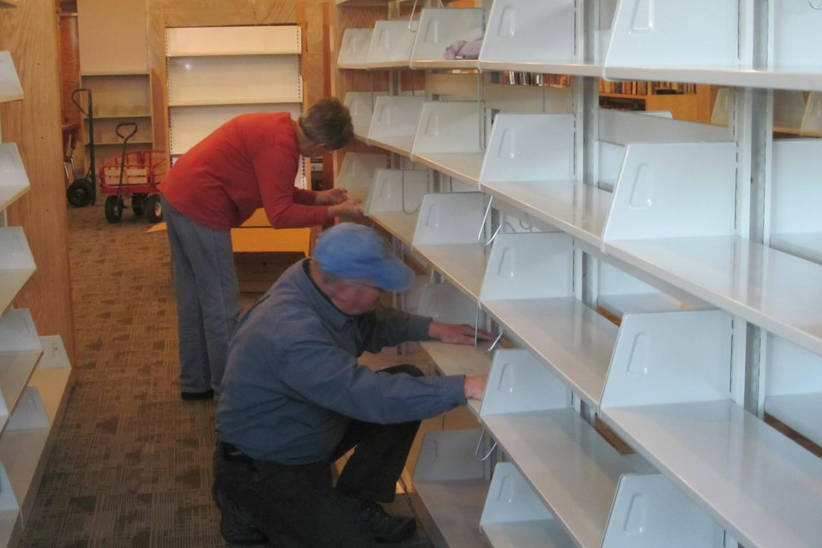 photo of volunteers assisting with move